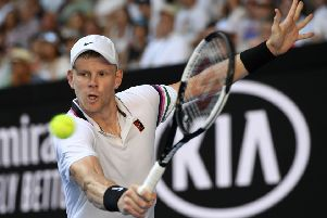 Britain's Kyle Edmund makes a backhand return to Tomas Berdych of the Czech Republic during their first round match at the Australian Open tennis championships in Melbourne. (AP Photo/Andy Brownbill)