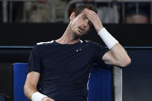 Spent: Andy Murray 'emptied the bucket' one last time in a vain attempt to prolong his career before ultimately falling short against Roberto Bautista Agut in the first round of the Australian Open. (AP Photo/Andy Brownbill)