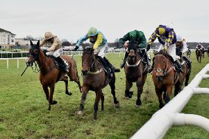 Wakanda, second left, wins the 2018 Sky Bet Chase at Doncaster with Henry Brooke on board.