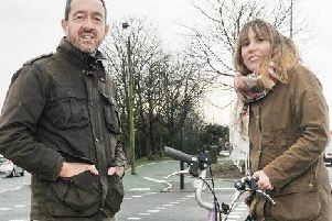 Chris Boardman and cyclist at the official opening of the new Saddle Junction cycle lanes