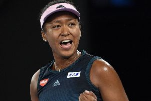 Japan's Naomi Osaka reacts after winning the first set against Karolina Pliskova of the Czech Republic during their semifinal at the Australian Open tennis championships in Melbourne. (AP Photo/Andy Brownbill)