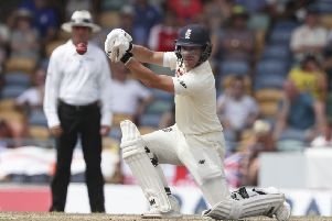 England's Rory Burns plays a shot through the covers in his second innings score of 84 at the Kensington Oval in Bridgetown. Picture: AP/Ricardo Mazalan.