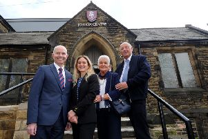Heckmondwike Grammar School headteacher Peter Roberts with the family of the late Jo Cox.