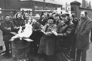 Trade unionists on strike at the Preston Council depot in Argyll Road keep warm on the picket line