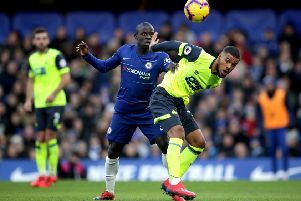 Chelsea's N'Golo Kante (left) and Huddersfield Town's Elias Kachunga battle for the ball.