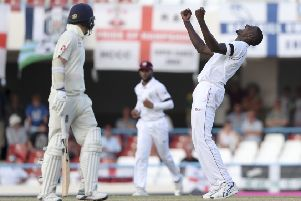 West Indies' captain Jason Holder celebrates the dismissal of England's James Anderson.