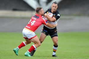 Dane Chisholm's drop-goal proved decisive as Bradford began the new season with  a narrow win over Featherstone.