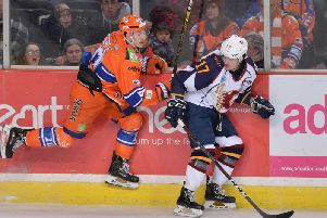 Tanner Eberle puts pressure on Guildford's TJ Foster. Picture: Dean Woolley.