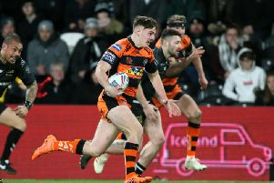 Castleford's Jake Trueman breaks clear of the Hull FC defence. (Richard Sellers/PA Wire)