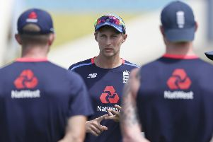 England's captain Joe Root speaks to his team-mates during a training session at the Darren Sammy Cricket Ground in Gross Islet, St. Lucia, on Friday (Picture: Ricardo Mazalan/AP).