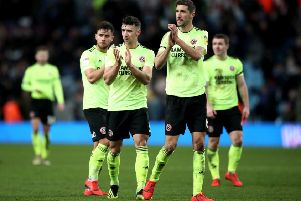 Sheffield United's Chris Basham applauds the travelling fans after the Blades had lost a three-goal lead to draw 3-3 with Aston Villa on Friday night (Picture: Nick Potts/PA Wire).