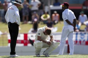 DOWN BUT NOT OUT ... YET: England's Jonny Bairstow crouches after being hit by a delivery during day two in St. Lucia. Picture: AP/Ricardo Mazalan