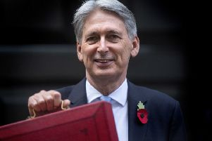A think tank has said Chancellor Philip Hammond will have to find billions of pounds of extar Government spending if he is to live up to Theresa May's pledge to end austerity. Photo: Victoria Jones/PA Wire