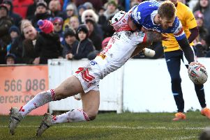 Wakefield's Tom Johnstone scores his first try against Saints.