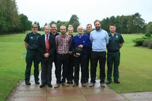 Chris Ennis (pictured in the middle) with his friends from Clitheroe Golf Club who revived him when he suffered a major heart attack