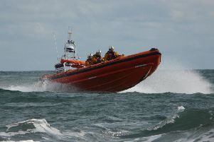 Newbiggin RNLI lifeboat crew in action. Picture by RNLI/Newbiggin