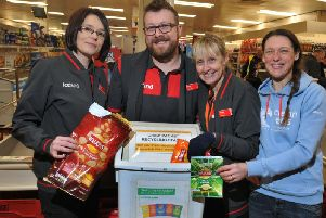 Iceland staff, Rebecca Elsden, Bradley Wainwright and Karen Evans, pictured with environmental campaigner Helen Dryden, and the Terracycle  project, encouraging customers to recycle empty crisp packets.