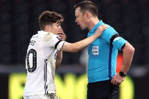 Swansea City's Daniel James speaks to referee Stuart Attwell during his side's FA Cup fifth round match with Brentford (Picture: Nick Potts/PA Wire).