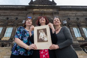 Harriet Stevens, Jess Rusell, and Rachel Stevens, daughters of Eric, holding a picture of the grandparents on thier Wedding Day in Vienna in 1920.
