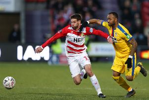 Doncaster Rovers' Matty Blair with Jordan Ayew of Crystal Palace during Sunday's FA Cup fifth-round tie at the Keepmoat Stadium (Picture: James Wilson/Sportimage).