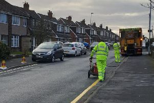 Workmen from Lancashire County Council could be seen in Broadwood Drive, Fulwood, today painting single yellow lines to restrict parking between the hours of 8am and 5pm