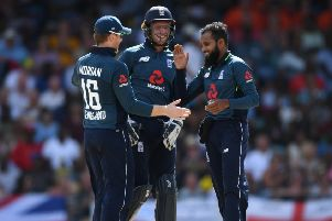 KEY MAN: Adil Rashid celebrates with Eoin Morgan and Jos Buttler after dismissing West Indies captain Jason Holder during the 1st One Day International match on Wednesday Picture: Gareth Copley/Getty Images