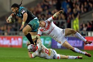 Konrad Hurrell gets away from Theo Fages and Louie McCarthy-Scarsbrook.  Picture: Bruce Rollinson