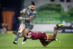 Warrington Wolves' Ben Murdoch-Masila (left) makes a break past Huddersfield Giants' Akuila Uate at the John Smith's Stadium. Picture: Danny Lawson/PA.