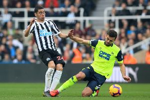 Key moment: Newcastle United's Miguel Almiron is brought down by Huddersfield Town's Tommy Smith, resulting in a red card.