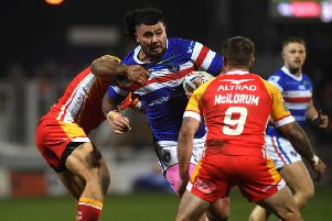Wakefield's David Fifita is tackled by Catalans' Sam Moa and Michael McIlorum.' Picture: Jonathan Gawthorpe