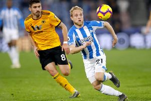Huddersfield Town's Alex Pritchard (right) and Wolverhampton Wanderers' Ruben Neves (Picture: PA)
