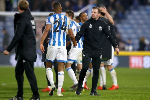 well done: Huddersfield Town head coach Jan Siewert shakes hands with match-winner Steve Mounie on Tuesday (Picture: Martin Rickett/PA Wire).