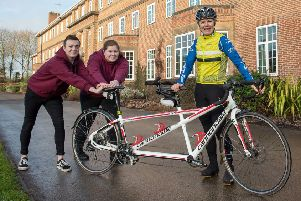 Catherine Dixon, chief executive of Askham Bryan College near York, pictured with college students, as she prepares to leave the college and set out on a world-record attempt around the world on a tandem bike ride.