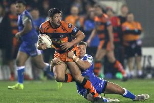 Castleford Tigers' Chris Clarkson (left) is tackled during Friday night's win over Hull KR. Picture: Simon Cooper/PA