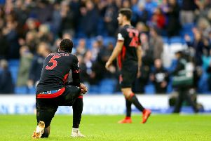 Huddersfield Town's Terence Kongolo appears dejected after the final whistle.