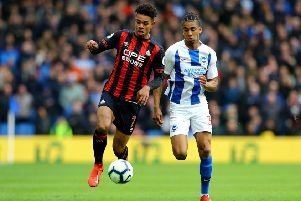 Competing all the way: Huddersfield Town's Juninho Bacuna ) and Brighton & Hove Albion's Bernardobattle for the ball.