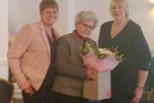Ribble Valley Macmillan chairman Susan Fillary, on the right, presenting flowers to Lady Milena Grenfell Baines.