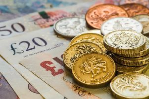 ADOBE STOCK'British coins stack on black, pound sterling