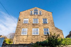 This stunning house on Oldham Road, Riponden, is filled with light and views thanks to an abundance of windows.