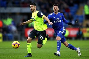 LEADER: Huddersfield Town's Christopher Schindler (left)  battles for the ball with Cardiff City's Victor Camarasa. Picture: Nick Potts/PA
