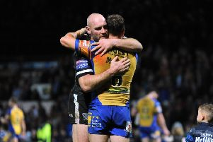 Gareth Ellis and Dannyy McGuire embrace at the end of the Super League semi-final clash at Headingley in September 2017.  Picture: Bruce Rollinson
