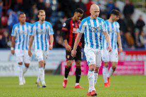 Huddersfield Town's Aaron Mooy leaves the pitch.