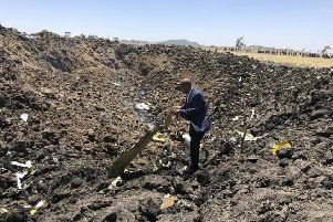 The CEO of Ethiopian Airlines, Tewolde Gebremariam, looks at the wreckage of the plane that crashed shortly after takeoff from Addis Ababa.