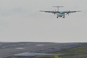 An Aer Lingus flight from Dublin lands in high winds at Leeds Bradford during Storm Freya on March 4