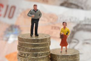 File photo dated 27/01/15 of plastic models of a man and woman standing on a pile of coins and bank notes. Nearly eight out of 10 companies and public sector bodies pay men more than women as the deadline passed for organisations to report their gender pay gaps. PRESS ASSOCIATION Photo. Issue date: Thursday April 5, 2018. Businesses with 250 employees or more were required to submit the data on mean and median gender pay gaps to the Government Equalities Office by midnight on Wednesday. See PA story INDUSTRY GenderPay. Photo credit should read: Joe Giddens/PA Wire