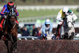 Beware The Bear (left) and Vintage Clouds (right) clear the last in the Ultima Handicap Chase at Cheltenham.