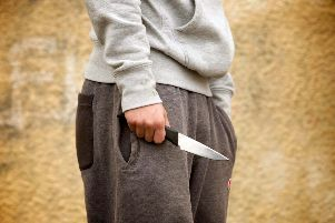 Former police officer GP Taylor is calling for radical action to stop the tide of knife crime. Picture posed by model.