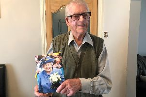 Jack Russell with a card sent from the Queen to mark his 75th wedding anniversary to wife June in February.