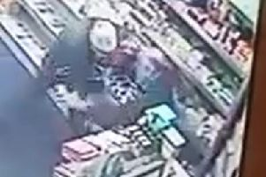 A Batley shopkeeper had to wrestle a man wielding a knife from his store yesterday.