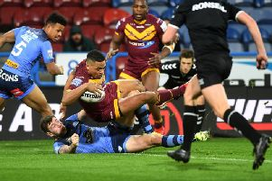 Huddersfield Giants' Jordan Turner is too strong as he crosses against his former team St Helens. (PIC: Jonathan Gawthorpe)
